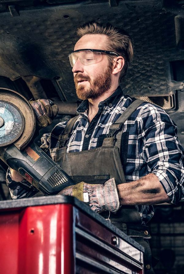 mechanic-in-protective-googles-holds-angle-grinder-small.jpg