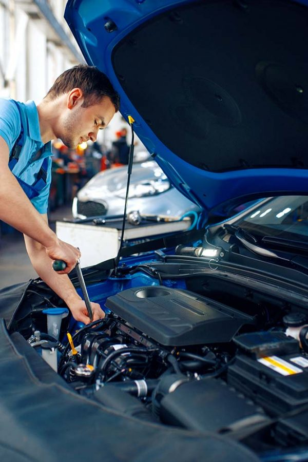 worker-in-uniform-checks-engine-car-service-small.jpg